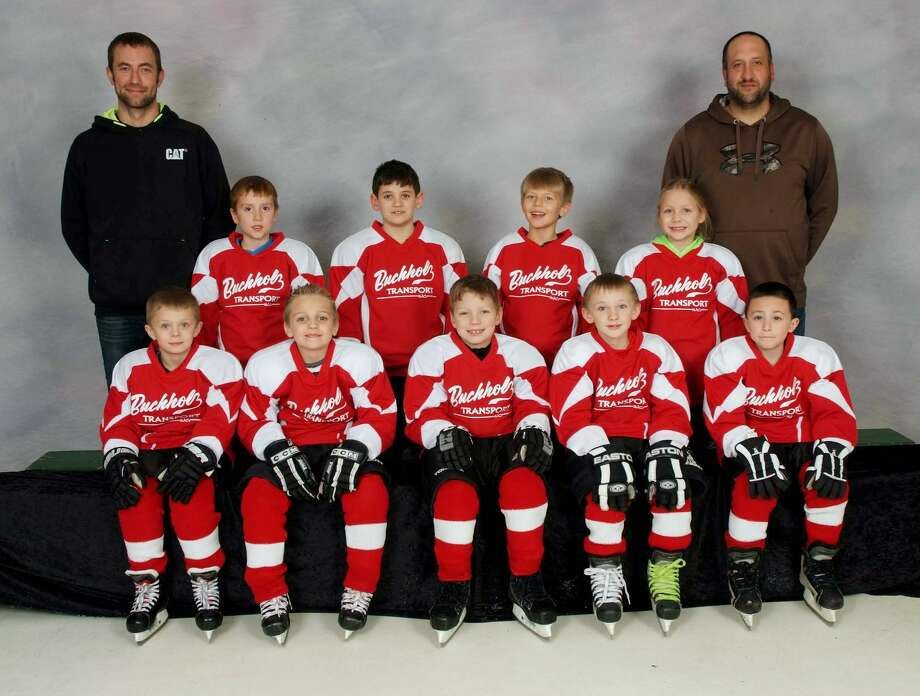 Members of the Buchholz Transportation U8 team are (front row from left) Collin Vanvalkenburgh, Bayler Schillinger, Xavier Sweeney, Nick Stirrett and Derek Kramer (back row) coach Kyle Buchholz, Cody O'Neil, Ben Herzog, Wyatt Buchholz, Anastasia Warchuck and coach John Herzog.  Photo: TSS Photography