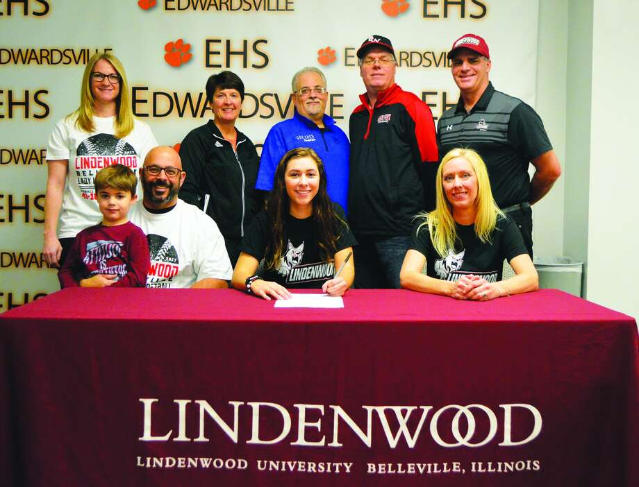 Edwardsville senior Jordyn Henricks, seated center, will play softball for Lindenwood University in Belleville.  Joining Jordyn in the picture, seated left to right, are Bill Henricks, father, Liam Henricks, brother, and Stacey Hughes, mother. Standing from left to right are Lisa Henricks, EHS coach Lori Blade, coach Jim Greiner, Black Widows coach Darren Zobrist and Lindenwood-Belleville coach Charlie Kennedy.