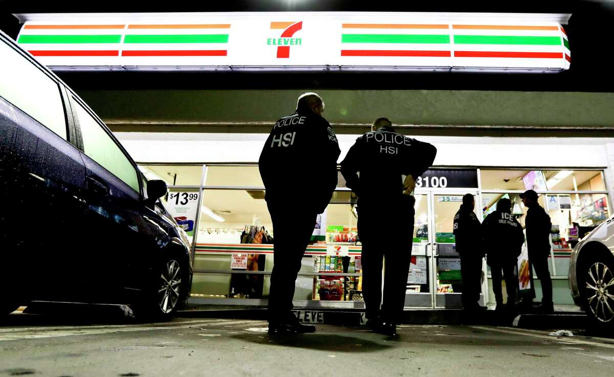 U.S. Immigration and Customs Enforcement agents serve an employment audit notice at a 7-Eleven convenience store Wednesday, Jan. 10, 2018, in Los Angeles. Agents said they targeted about 100 7-Eleven stores nationwide Wednesday to open employment audits and interview workers. (AP Photo/Chris Carlson)