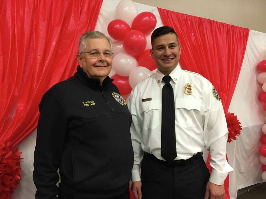 A Dec. 30 reception at Community Volunteer Fire Station at 16003 Bellaire Blvd., Houston, honored longtime fire chief Steve Fowler, left, who retired Jan. 1. Bobby Clark, right, is the new chief of the department. Photo: Karen Zurawski