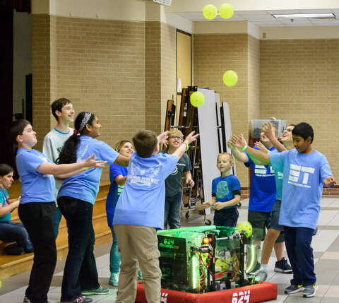 289dde541334 Members of the Memorial Parkway Junior High Eagle robotics team get ready  to catch balls launched