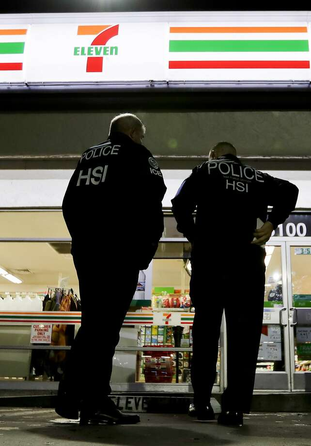 U.S. Immigration and Customs Enforcement agents serve an employment audit notice at a 7-Eleven convenience store Wednesday, Jan. 10, 2018 in Los Angeles. Agents said they targeted about 100 7-Eleven stores nationwide Wednesday to open employment audits and interview workers. (AP Photo/Chris Carlson) Photo: Chris Carlson, Associated Press