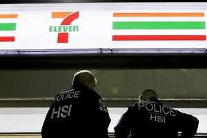 U.S. Immigration and Customs Enforcement agents serve an employment audit notice at a 7-Eleven convenience store Wednesday, Jan. 10, 2018 in Los Angeles. Agents said they targeted about 100 7-Eleven stores nationwide Wednesday to open employment audits and interview workers. (AP Photo/Chris Carlson)