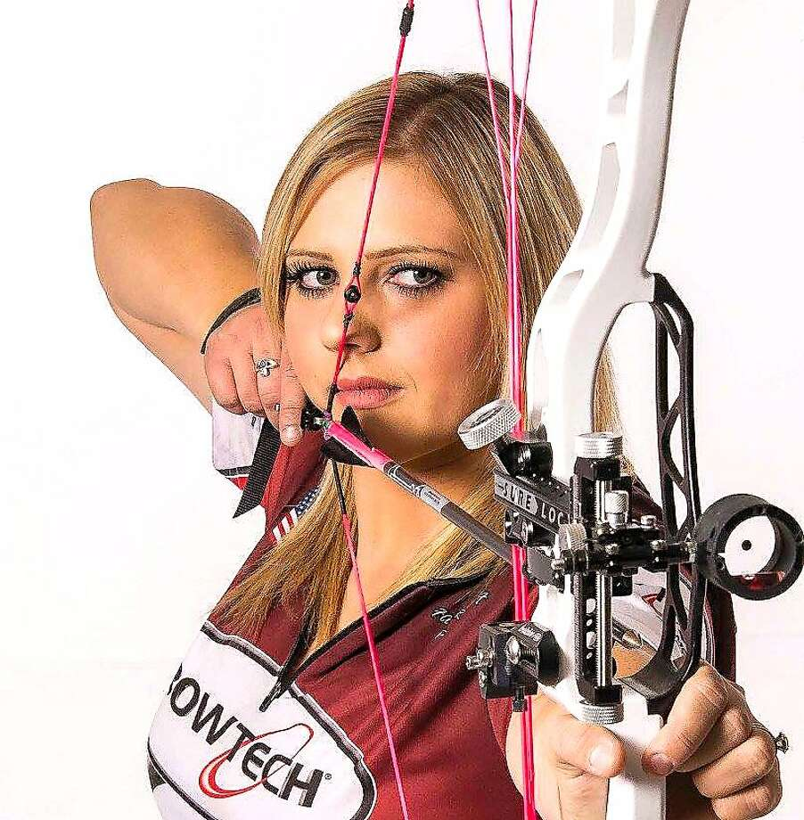 "Paige Pearce-Gore is a world-renown competitive archer who doubles as a youth outdoors instructor who has networks with the Congressional Sportsmen's Foundation, who as 22, was selected as California's ""New Mover, Shaker"" by the California Outdoors Hall of Fame and will be inducted at the Sportsmen's Expo on Jan. 20 Photo: Tom Stienstra, Courtesy Paige Pearce-Gore"