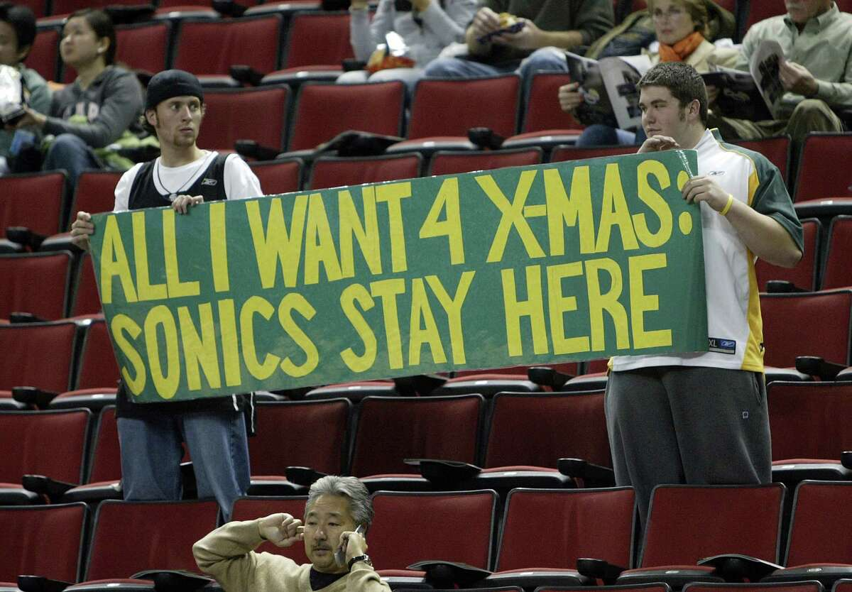 FILE -- Seattle Supersonics fans Chad Scarbrough and Michael Mitchusson, both from Enumclaw, Wash., let their feeling be known prior to the Sonics game against the Portland Trailblazers at Key Arena in Seattle, Wash., Wednesday, Nov. 1, 2006. Seattle Post-Intelligencer Photo By Mike Urban