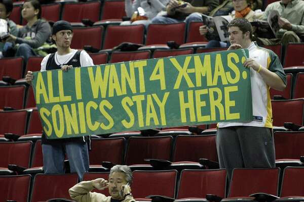 Seattle Supersonics fans Chad Scarbrough and Michael Mitchusson, both from Enumclaw, Wash., let their feeling be known prior to the Sonics game against the Portland Trailblazers at Key Arena in Seattle, Wash., Wednesday, Nov. 1, 2006. Seattle Post-Intelligencer Photo By Mike Urban