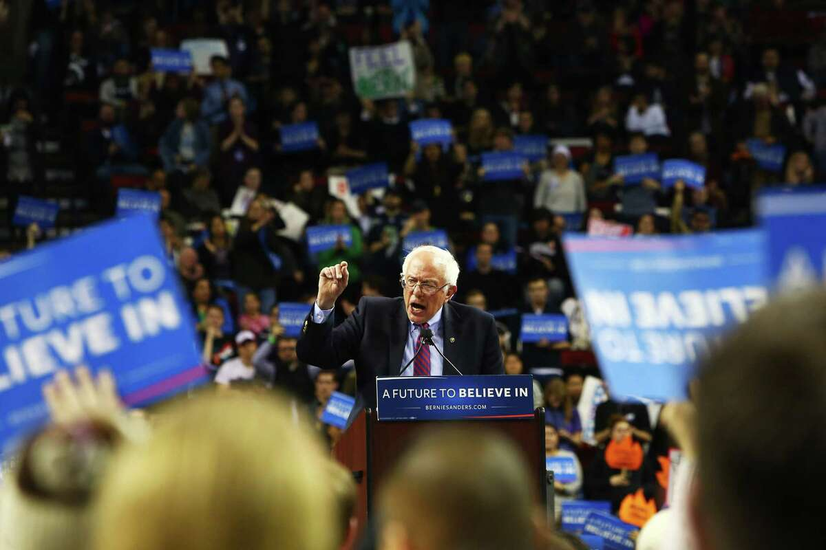 """Bernie Sanders speaks to crowds at a rally at Key Arena, Sunday, March 20, 2016. He swept Washington's precinct caucuses. But we have switched to a primary in 2020. Will Washington still feel """"the Bern""""?"""