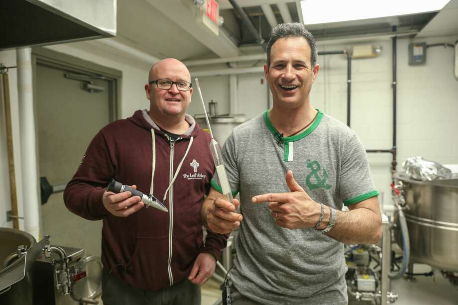 Dogfish Head Brewery's Sam Calagione and BeerAdvocate co-founders Jason and Todd Alstrom team up annually for Extreme Beer Fest, a festival celebrating experimental beers. In late 2017, they also released a companion homebrewer's cookbook, featuring recipes submitted by The Rare Barrel, the Lost Abbey and others. (Pictured l-r: The Lost Abbey/Port Brewing's Tomme Arthur, Sam Calagione.) Photo: Courtesy Dogfish Head Brewery