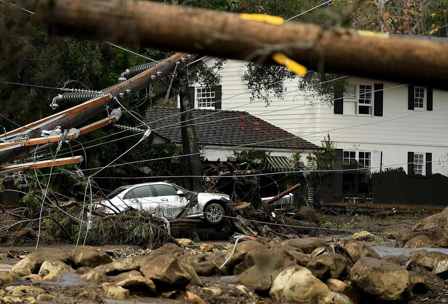 A car sits along along Olive Mill Road in Montecito after a major storm hit the burn area Tuesday, Jan. 9, 2018. (Wally Skalij/Los Angeles Times/TNS) Photo: Wally Skalij, TNS