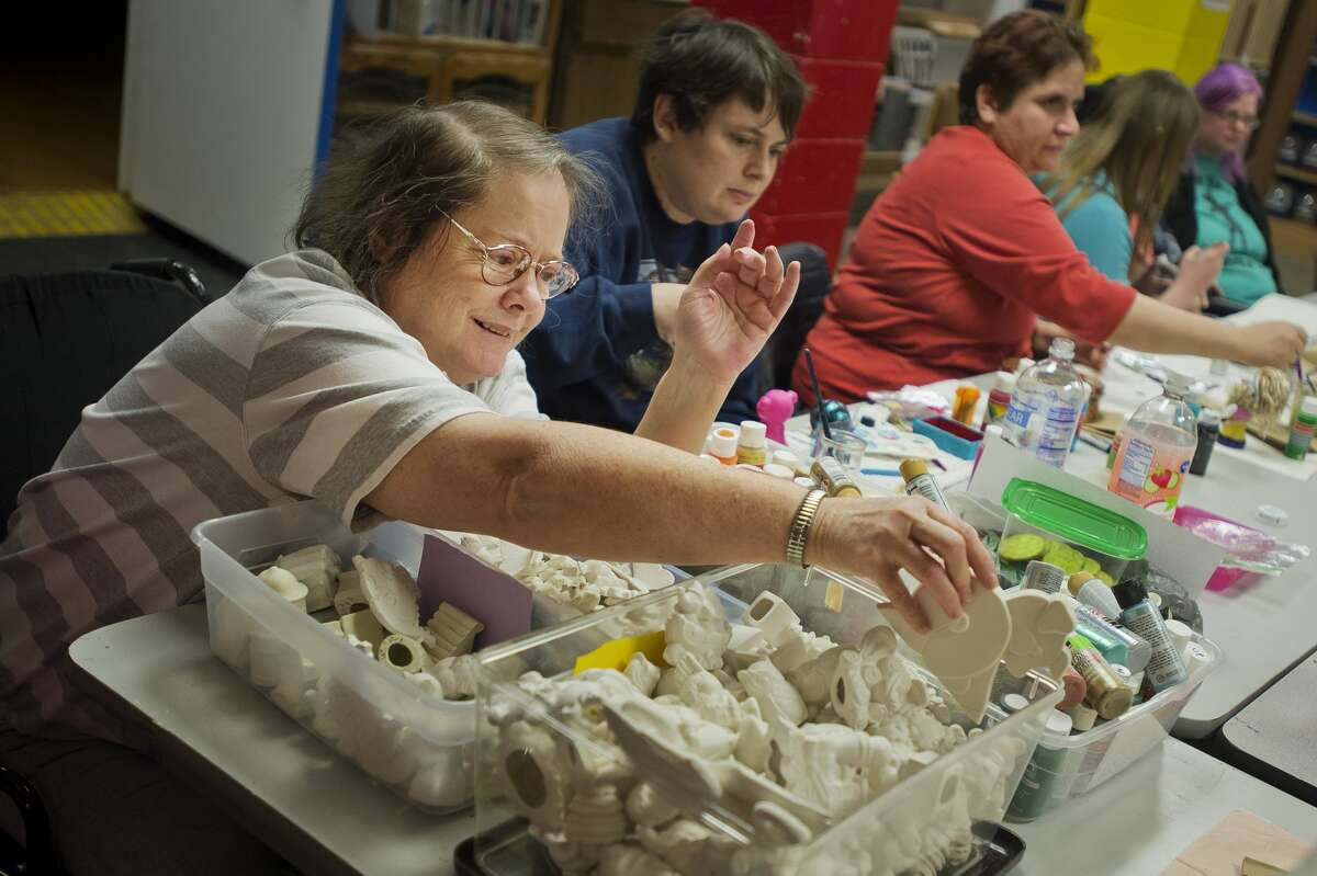Nancy McGregor of Midland looks through bins of ceramic figurines as she decides on her next project during a ceramics class on Wednesday, Jan. 10, 2018 at Creative 360. (Katy Kildee/kkildee@mdn.net)