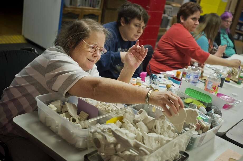 Nancy McGregor of Midland looks through bins of ceramic figurines as she decides on her next project during a ceramics class on Wednesday, Jan. 10, 2018 at Creative 360. (Katy Kildee/kkildee@mdn.net) Photo: (Katy Kildee/kkildee@mdn.net)