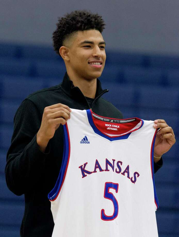 College Park senior Quentin Grimes announces his commitment to play basketball at the University of Kansas during a signing ceremony at College Park High School, Wednesday, Nov. 15, 2017. Photo: Jason Fochtman, Staff Photographer / © 2017 Houston Chronicle