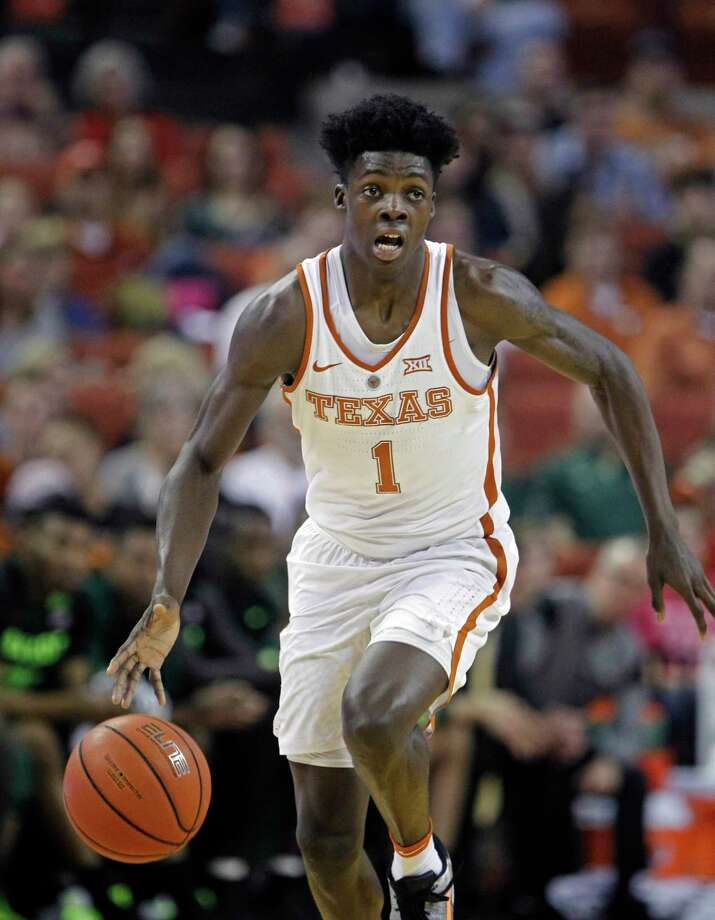 FILE - In this March 4, 2017, file photo, Texas guard Andrew Jones dribbles the ball during the second half of an NCAA college basketball game against Baylor, in Austin, Texas. Texas announced, Wednesday, Jan. 10, 2018, that sophomore guard Andrew Jones has leukemia and has started treatment. Jones was the Longhorns leading scorer before he was sidelined by a broken wrist. He played sparingly in his return after complaining of low energy and was sent for tests. (AP Photo/Michael Thomas, File) Photo: Michael Thomas, FRE / FR65778 AP