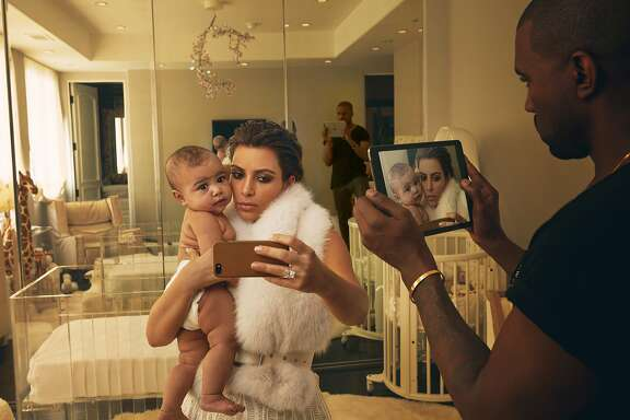 In the latest season of Keeping up with the Kardashians, Kim Kardashian, shown here with her daughter North West and husband Kanye West in 2014, believes she may have lupus. Author Emily Sheng, who suffers from the autoimmune disease, writes about what the show gets both right and wrong about the disorders that threaten a growing number of people.