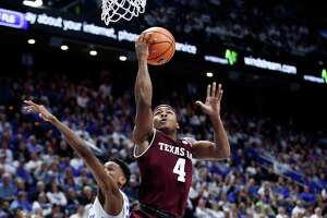 LEXINGTON, KY - JANUARY 09:  JJ Caldwell #22 of the Texas A&M Aggies shoots the ball against the Kentucky Wildcats during the game at Rupp Arena on January 9, 2018 in Lexington, Kentucky.