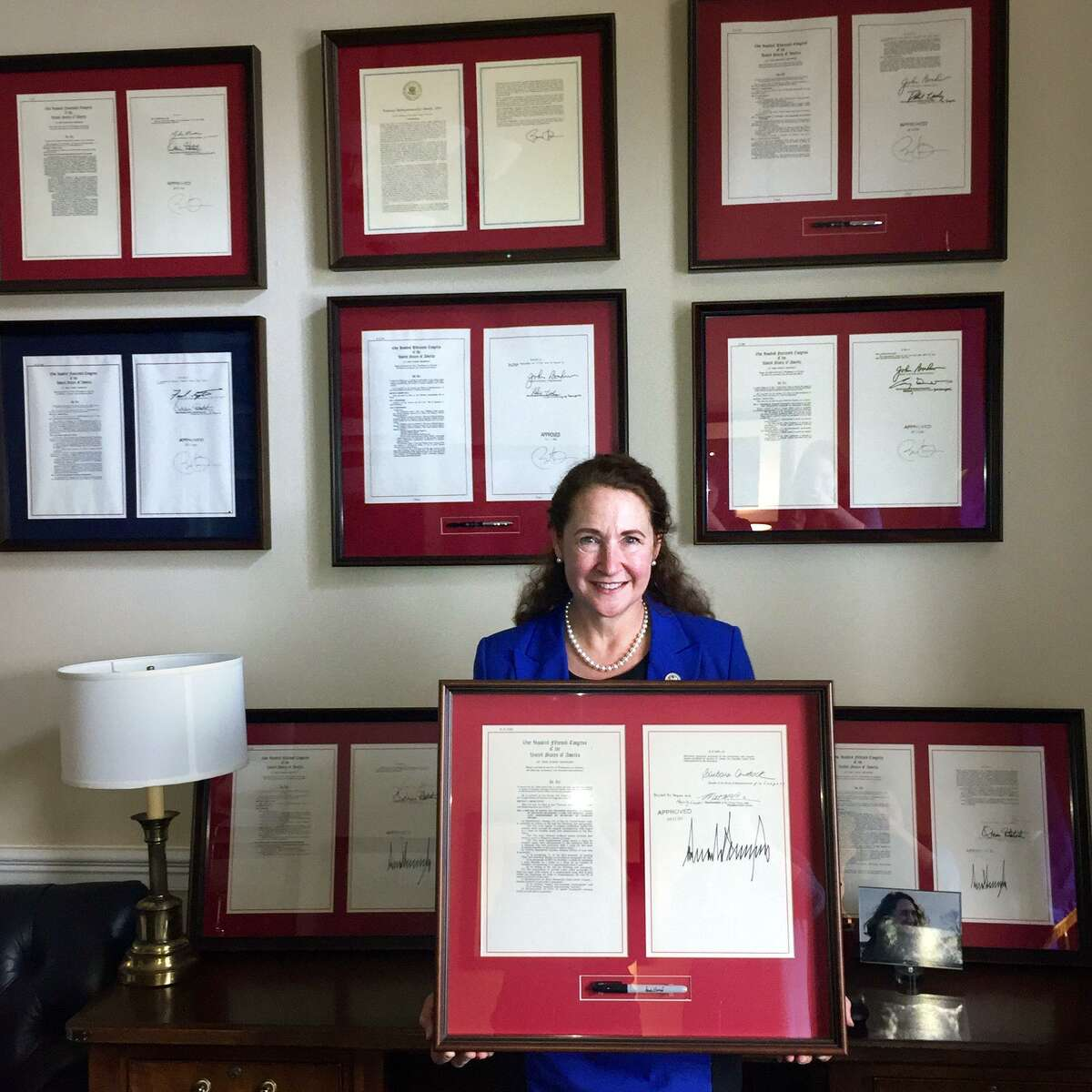 Rep. Elizabeth Esty's office wall features legislation she authored that got signed into law.