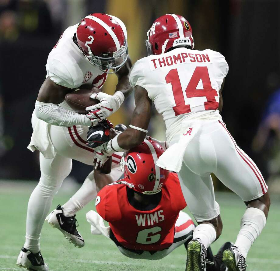 Alabama's Tony Brown, left, intercepts a pass to Javon Wimms, center, while Deionte Thompson defends on the opening drive during the first quarter in the College Football Playoff National Championship at Mercedes-Benz Stadium on Monday, Jan. 8, 2018, in Atlanta, Ga. (Curtis Compton/Atlanta Journal-Constitution/TNS) Photo: Curtis Compton, MBR / Atlanta Journal-Constitution