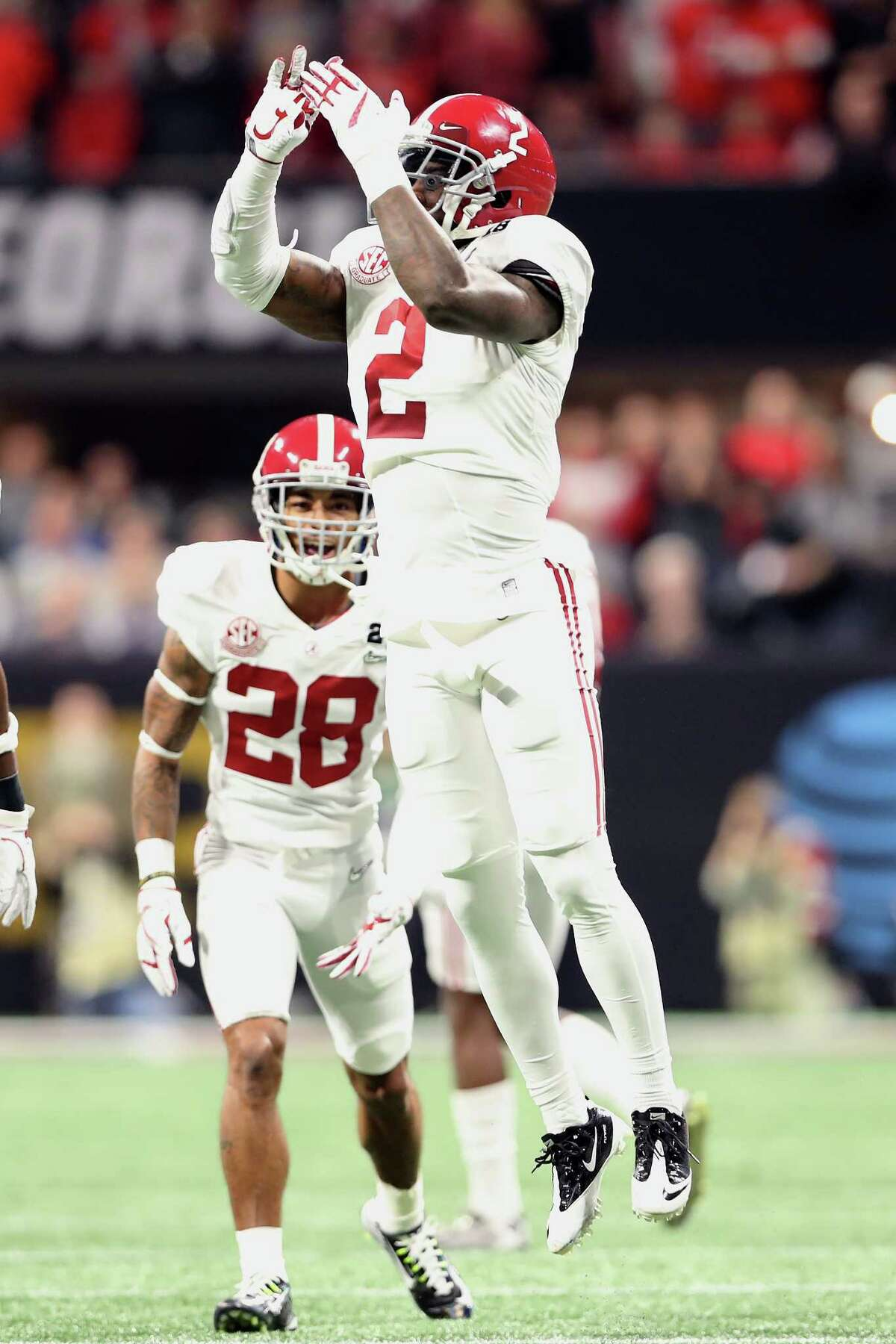 ATLANTA, GA - JANUARY 08: Tony Brown #2 of the Alabama Crimson Tide celebrates an interception against the Georgia Bulldogs during the first quarter in the CFP National Championship presented by AT&T at Mercedes-Benz Stadium on January 8, 2018 in Atlanta, Georgia. (Photo by Christian Petersen/Getty Images)