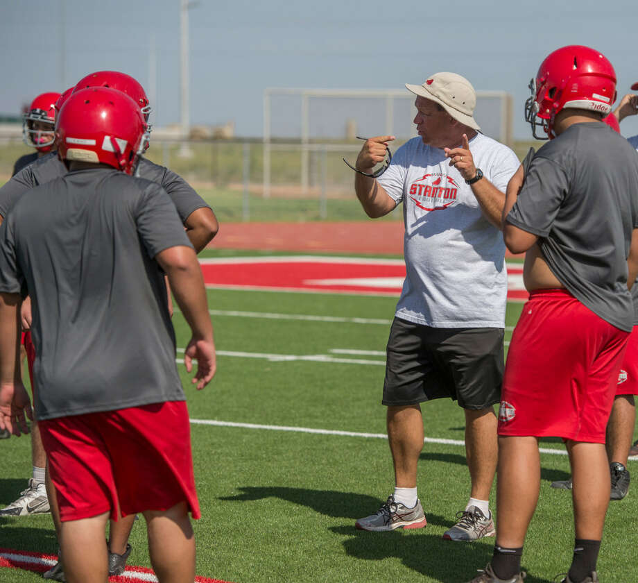 Stanton head football coach John Peterson works with his players Wednesday 08-03-16 during practice. Tim Fischer/Reporter-Telegram