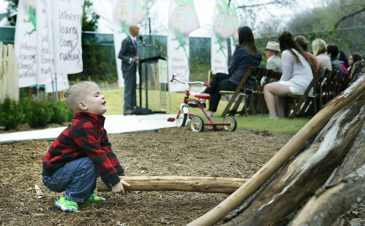 Jude Knueve, 3, a future student at Will Smith Zoo School, plays with logs during The San Antonio Zoo official opening of the Will Smith Zoo School that fosters an appreciation of animals and plants with a nature-based curriculum, outside activities and an exploration of the zoom, on Wednesday, Jan. 10, 2018.
