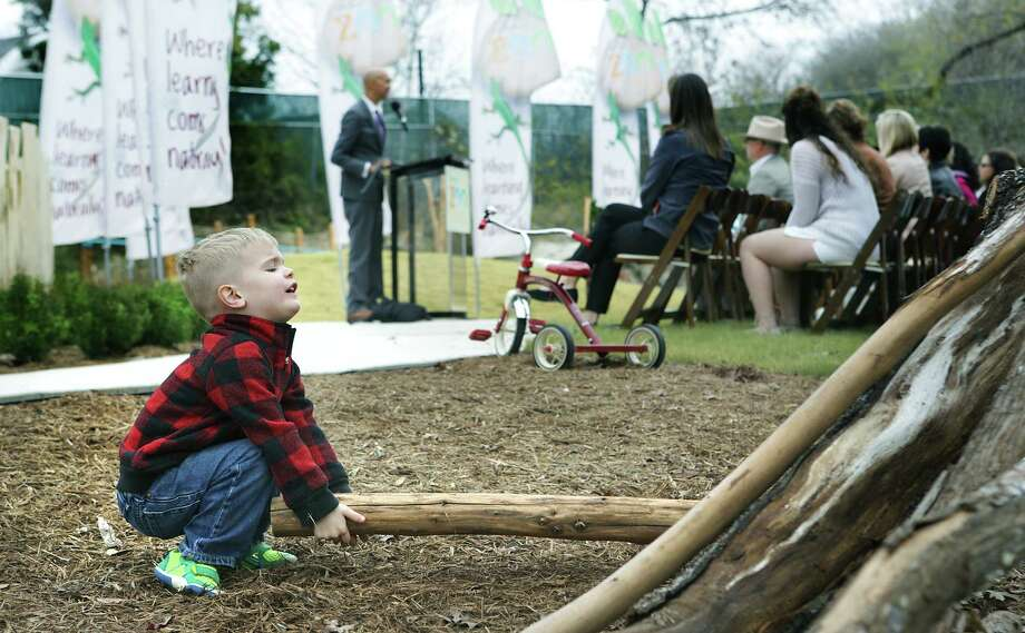 Jude Knueve, 3, a future student at Will Smith Zoo School, plays with logs during The San Antonio Zoo official opening of the Will Smith Zoo School that fosters an appreciation of animals and plants with a nature-based curriculum, outside activities and an exploration of the zoom, on Wednesday, Jan. 10, 2018. Photo: Bob Owen, San Antonio Express-News / ©2017 San Antonio Express-News