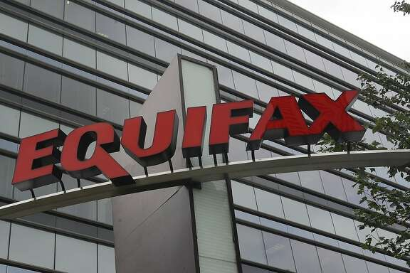 FILE - This July 21, 2012, file photo shows signage at the corporate headquarters of Equifax Inc. in Atlanta.  Equifax says a special committee has determined that four executives did not commit insider trading prior to public disclosure of its massive data breach. The credit rating agency said Friday, Nov. 3, 2017,  that committee found that none of the executives had knowledge of the breach when their trades were made and that preclearance for the trades was obtained properly. (AP Photo/Mike Stewart, File)