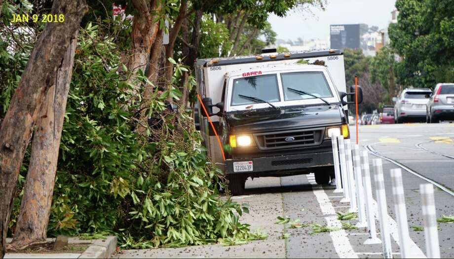 San Francisco resident John Entwistle says a GardaWorld armored vehicle drove down a bike lane at 17th and Sanchez streets and crashed into a tree on Tuesday, Jan. 10, 2018. Photo: Courtesy John Entwistle