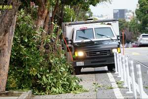 San Francisco resident John Entwistle says a GardaWorld armored vehicle drove down a bike lane at 17th and Sanchez streets and crashed into a tree on Tuesday, Jan. 10, 2018.