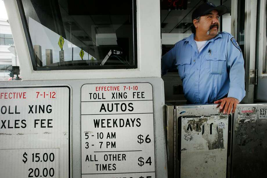Toll collector Willie Gutierrez works at the Bay Bridge in January. Regional Measure 3 would raise tolls by $3 at state-run bridges. Photo: Santiago Mejia / The Chronicle