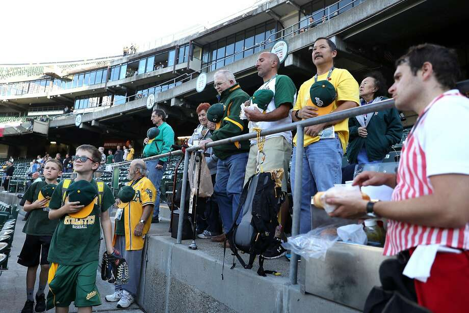 Oakland Athletics' fans stand during National Anthem at Oakland Coliseum in Oakland, Calif. on Monday, July 17, 2017. Photo: Scott Strazzante, The Chronicle