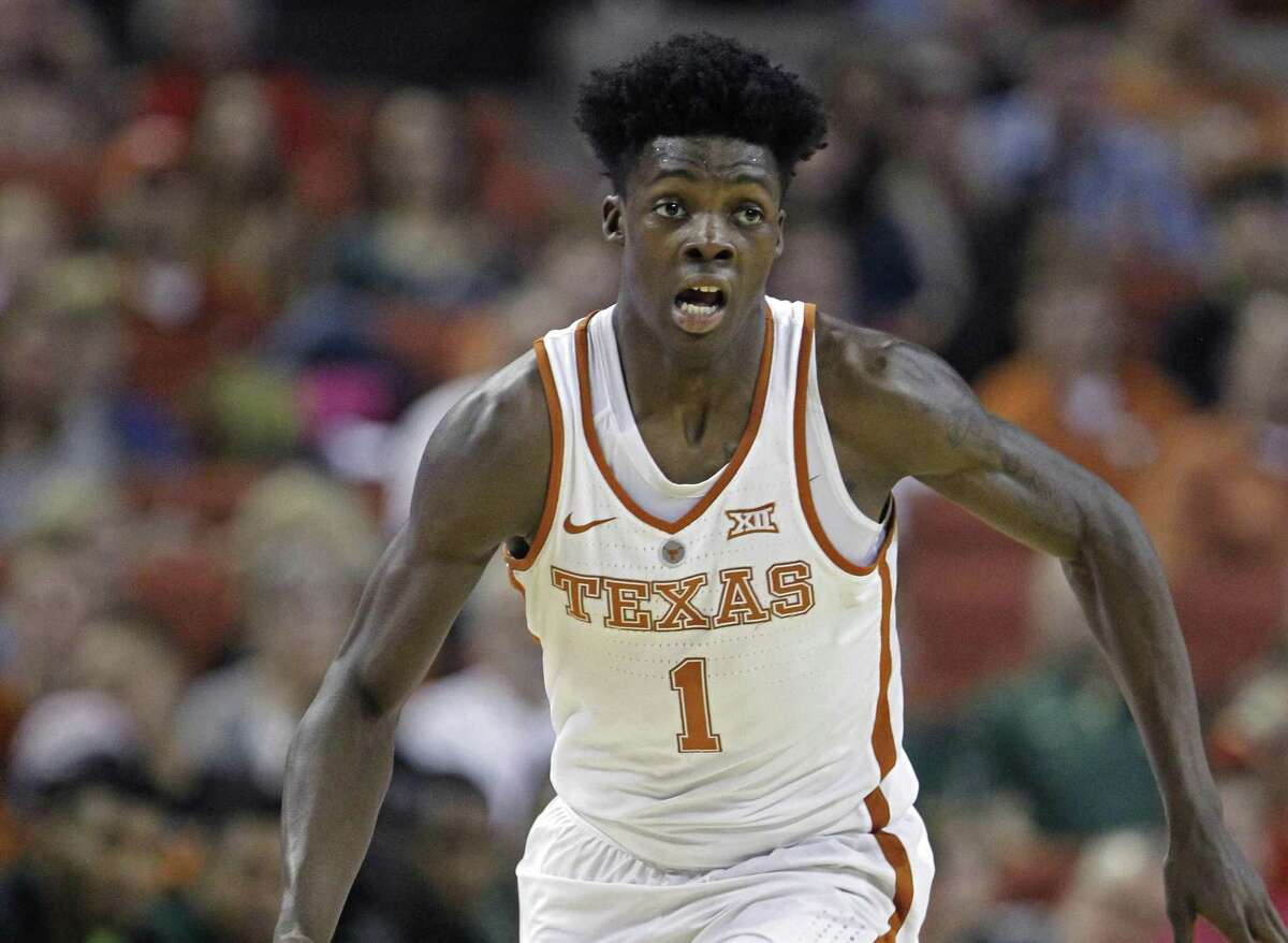 Texas guard Andrew Jones dribbles the ball during the second half against Baylor, in Austin, Texas. Texas announced, Wednesday that Jones has leukemia and has started treatment.