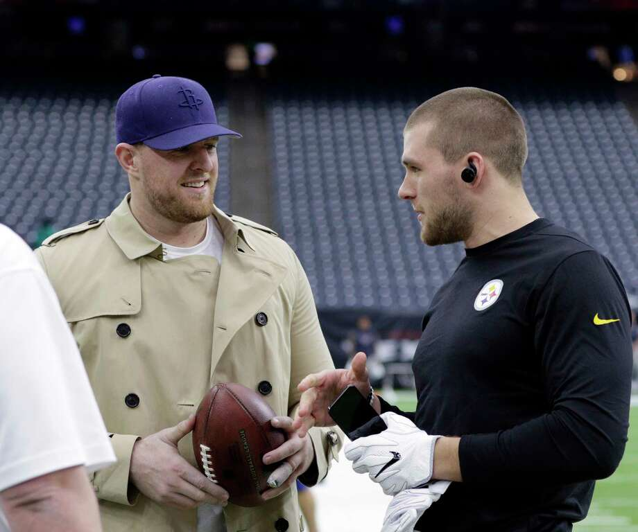 PHOTOS: A look at the NFL's Watt BrothersPittsburgh Steelers outside linebacker T.J. Watt, right, talks with his brother, Houston Texans defensive end J.J. Watt, left, before an NFL football game Monday, Dec. 25, 2017, in Houston. (AP Photo/Michael Wyke) Photo: Michael Wyke, Associated Press / Michael Wyke 2017 918-282-3233 www.michaelwyke.com