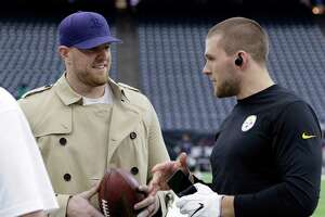 Pittsburgh Steelers outside linebacker T.J. Watt, right, talks with his brother, Houston Texans defensive end J.J. Watt, left, before an NFL football game Monday, Dec. 25, 2017, in Houston. (AP Photo/Michael Wyke)