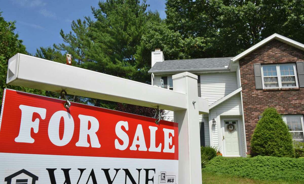 For sale sign on the lawn of a house on Sudbury Rd. in Bethlehem Thursday July 19, 2012. (John Carl D'Annibale / Times Union)