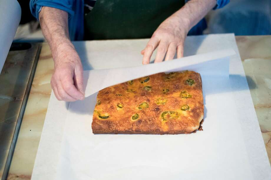 Josephine Soracco wraps focaccia at Liguria Bakery in San Francisco. Photo: Noah Berger, Special To The Chronicle