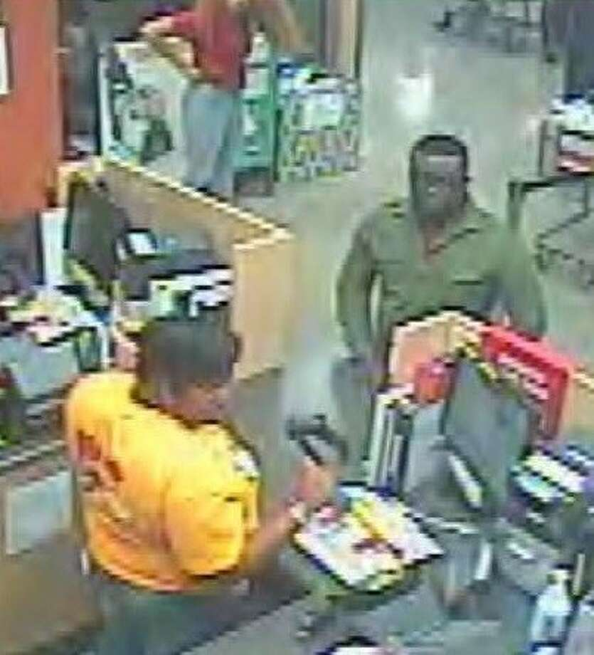 Surveillance video footage shows a man suspected of committing identity theft in order to steal more than $90,000.