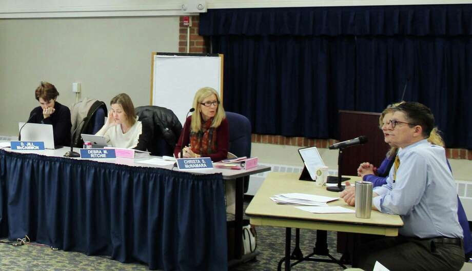 The Board of Education listens to a proposal for new English and media courses from Darien High School English teacher Francis Janosco, right, and Principal Ellen Dunn a school board meeting on Jan. 9, 2018 Photo: Erin Kayata / Hearst Connecticut Media / Darien News