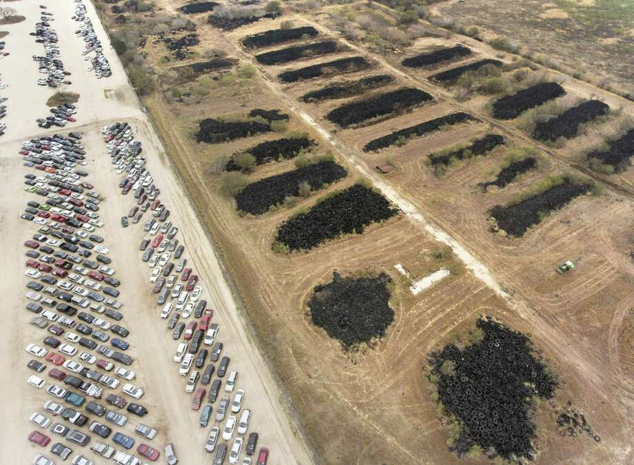 The former Safe Tire Disposal Corp. dump at 11150 Applewhite Rd. is seen Wednesday, Jan. 10, 2017 next to the Copart, Inc. vehicle auction and remarketing services company's San Antonio facility. Copart has bought the long-standing eyesore and health hazard and plans to clean up the site to expand its facility. Photo: William Luther, Staff / San Antonio Express-News / © 2018 San Antonio Express-News