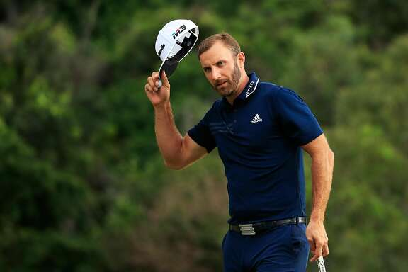 LAHAINA, HI - JANUARY 07:  Dustin Johnson of the United States celebrates on the 18th green after winning during the final round of the Sentry Tournament of Champions at Plantation Course at Kapalua Golf Club on January 7, 2018 in Lahaina, Hawaii.  (Photo by Cliff Hawkins/Getty Images)