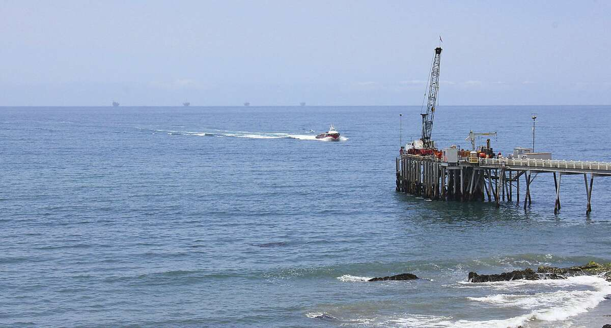FILE- This May 16, 2015, file photo shows oil drillings offshore of a service pier in the Santa Barbara Channel off the coast of Southern California near Carpinteria. Opposition to the Trump administration's plan to expand offshore drilling mounted Wednesday, Jan. 10, 2018. The plan could open up federal waters off the California coast for the first time in more than three decades. The Channel is one of those areas that could open up. (AP Photo/John Antczak, File)