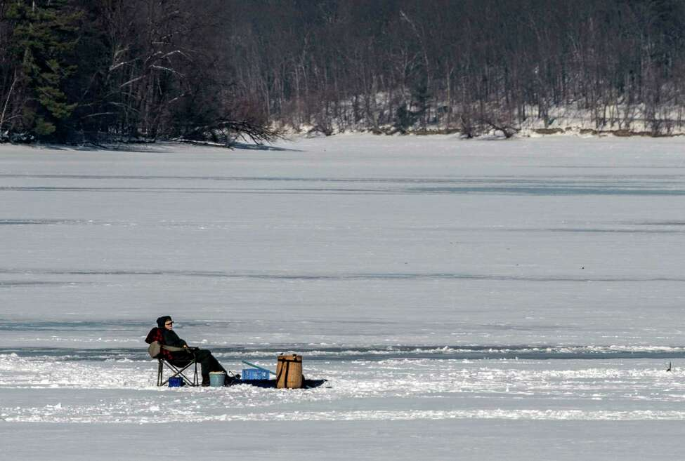Ice fisherman get some time on the ice on the Tomhannock Reservoir Wednesday Jan 10, 2018 in Pittstown, N.Y. (Skip Dickstein/Times Union)