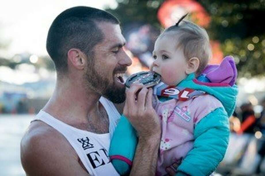 Cal Neff and daughter Holland celebrate after his victory in the 2016 Katy Half Marathon. Photo: Courtesy Cal Neff
