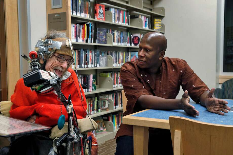 Hale Zukas (left) laughs as he talks with film director Brad Bailey at the Berkeley Library. Zukas, a well-known figure around Berkeley, continues his advocacy for full rights and access for people with disabilities. Photo: Carlos Avila Gonzalez, The Chronicle