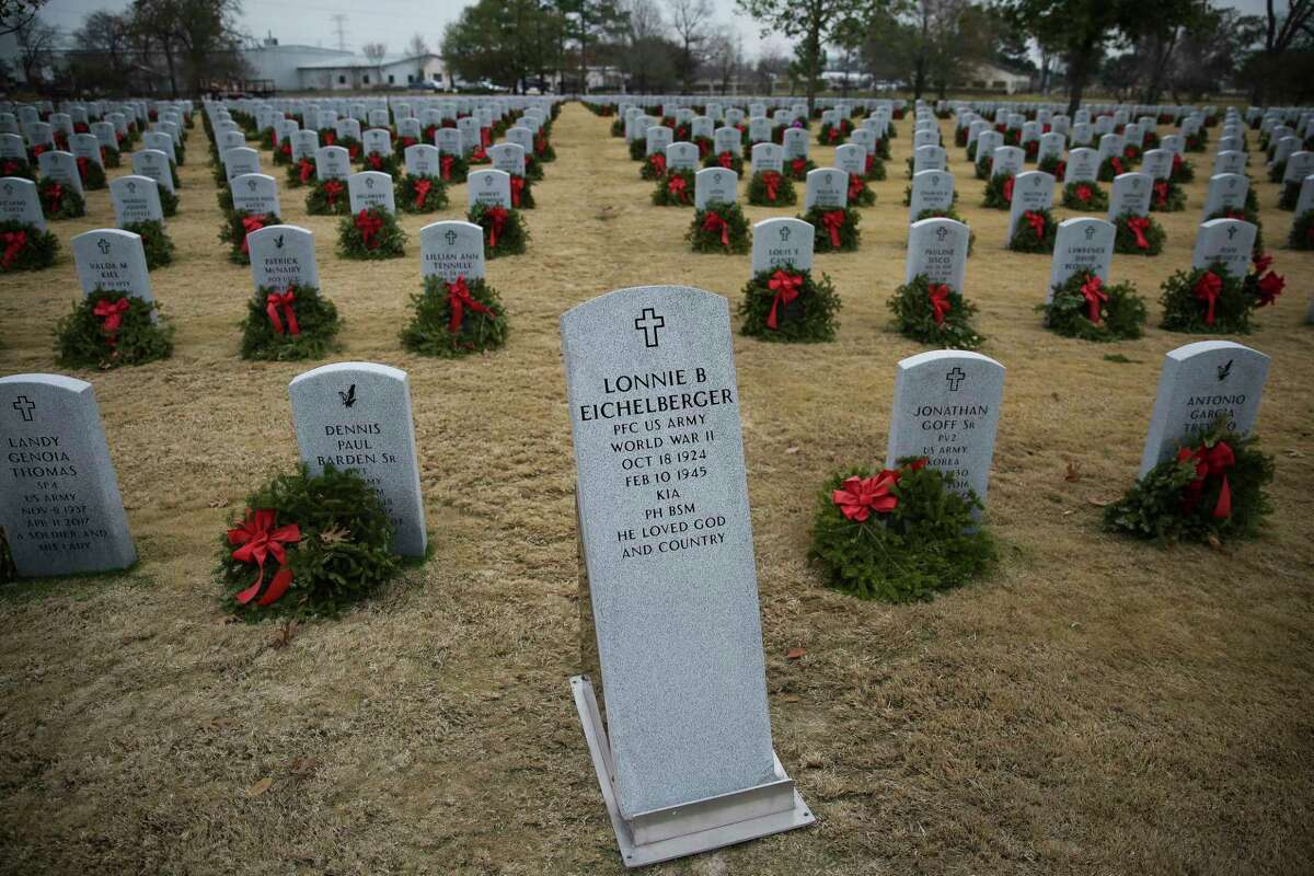 The headstone for Pfc. Lonnie Eichelberger sits next to his newly dug grave Wednesday, Jan. 10, 2018 at the Houston National Cemetery in Houston. Eichelberger's remains were recently identified and returned home after he died in combat in Italy during World War II. Eichelberger enlisted in one of the only black infantry divisions as a teenager and was missing since a 1945 battle until recent dental and DNA analysis was able to identify him and 11 other soldiers from that battle. ( Michael Ciaglo / Houston Chronicle)