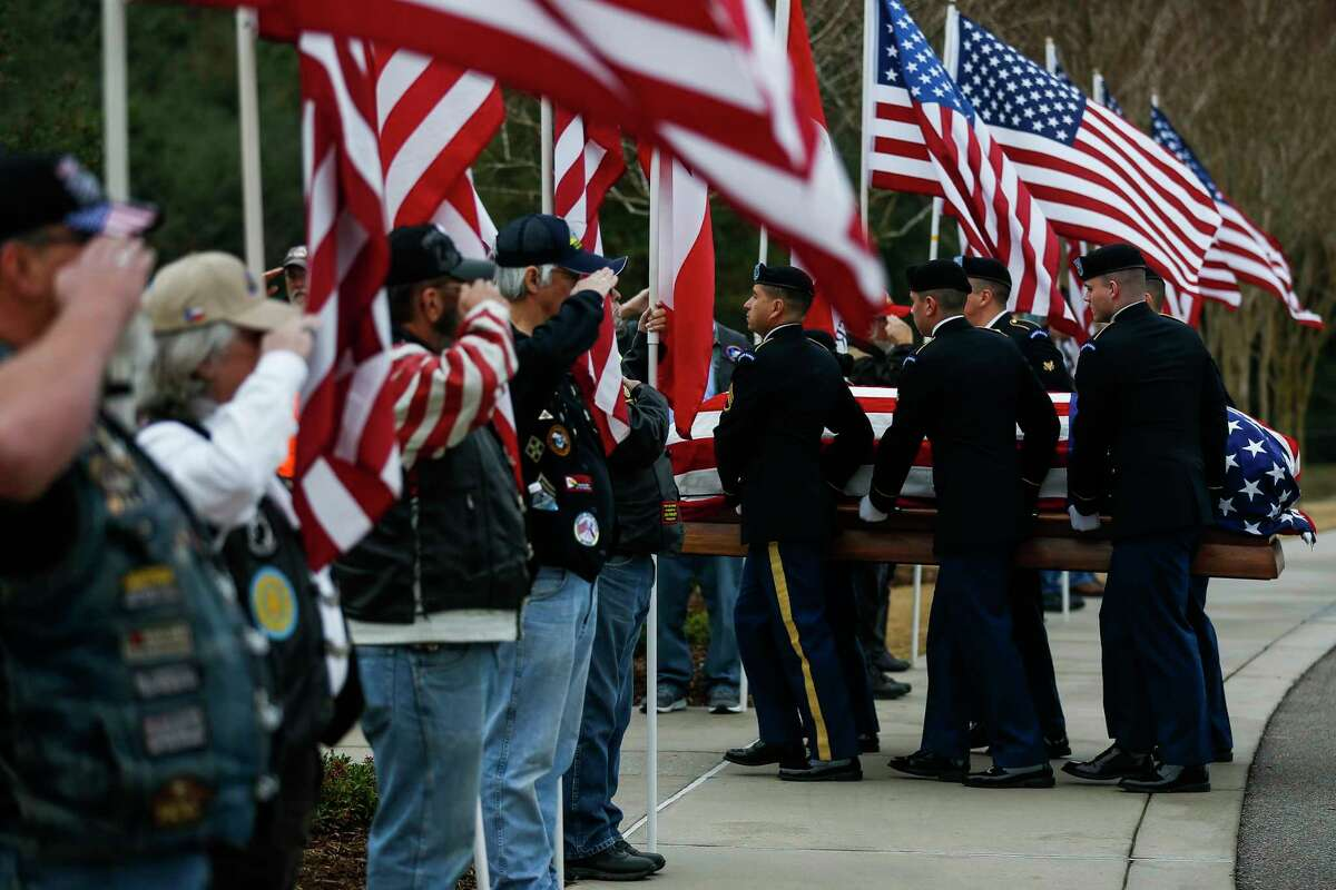 Honor guard members move the body of Pfc. Lonnie Eichelberger past a row of Patriot Guard Riders during a funeral service at the Houston National Cemetery Wednesday, Jan. 10, 2018 in Houston. Eichelberger's remains were recently identified and returned home after he died in combat in Italy during World War II. Eichelberger enlisted in one of the only black infantry divisions as a teenager and was missing since a 1945 battle until recent dental and DNA analysis was able to identify him and 11 other soldiers from that battle. ( Michael Ciaglo / Houston Chronicle)