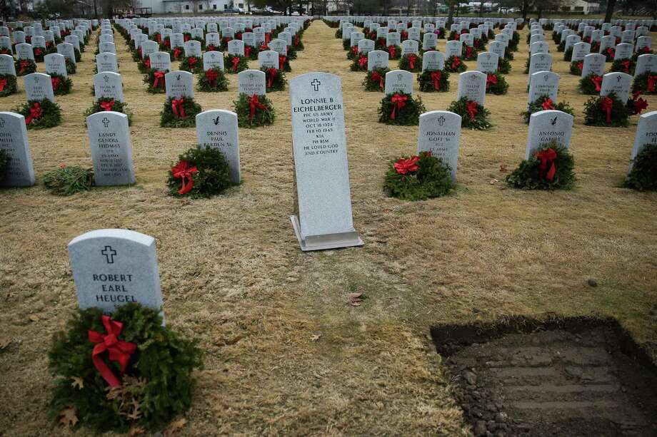 The headstone for Pfc. Lonnie Eichelberger sits next to his newly dug grave Wednesday, Jan. 10, 2018 at the Houston National Cemetery in Houston. Eichelberger's remains were recently identified and returned home after he died in combat in Italy during World War II. Photo: Michael Ciaglo, Houston Chronicle / Michael Ciaglo
