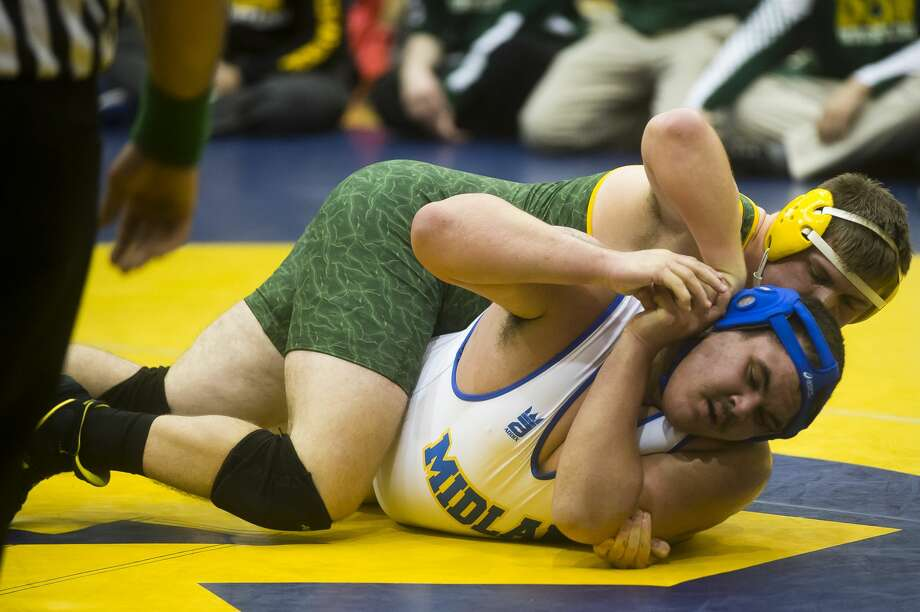 Dow's Brent Booth, top, wrestles Midland's R.J. Allen during a meet on Wednesday, Jan. 10, 2018 at Midland High School. (Katy Kildee/kkildee@mdn.net) Photo: (Katy Kildee/kkildee@mdn.net)