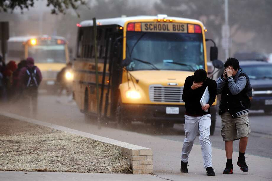 Lee High School students cover their faces as high winds kick up dirt and debris Jan. 10, 2018 near the school. James Durbin/Reporter-Telegram Photo: James Durbin