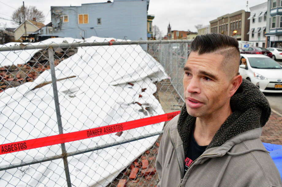 Greg Dyer looks over rubble from 226 and 228 Remsen Street destroyed in last week's fire Tuesday Dec. 6, 2017 in Cohoes, NY. Dyer whose apartment was in 226, spoke of losing irreplaceable family items.  (John Carl D'Annibale / Times Union) Photo: John Carl D'Annibale / 20042320A