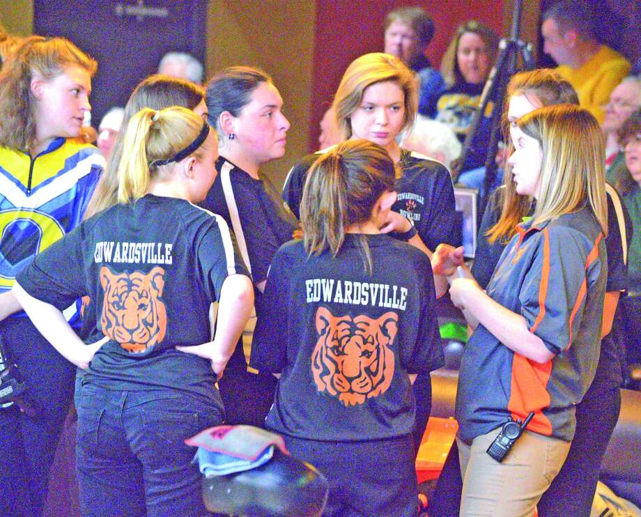 Edwardsville bowling coach Kimber Wilderman, right, talks to the EHS girls' team between the second and third games of Wednesday's dual match against O'Fallon at Edison's Entertainment Complex.